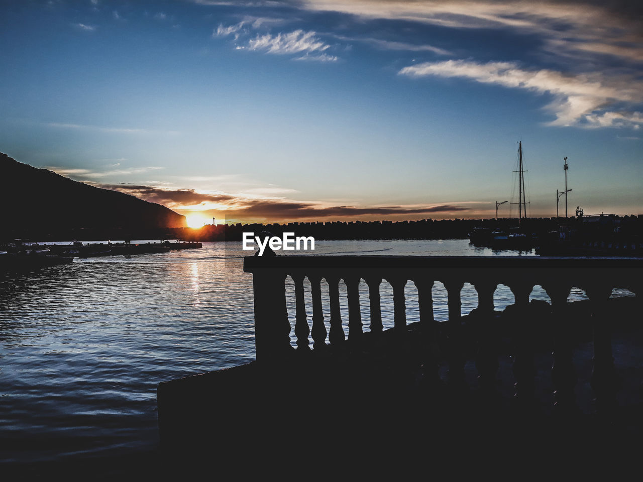 sky, sunset, water, cloud - sky, beauty in nature, scenics - nature, nature, silhouette, tranquil scene, tranquility, lake, architecture, built structure, orange color, no people, reflection, railing, outdoors, idyllic, wooden post