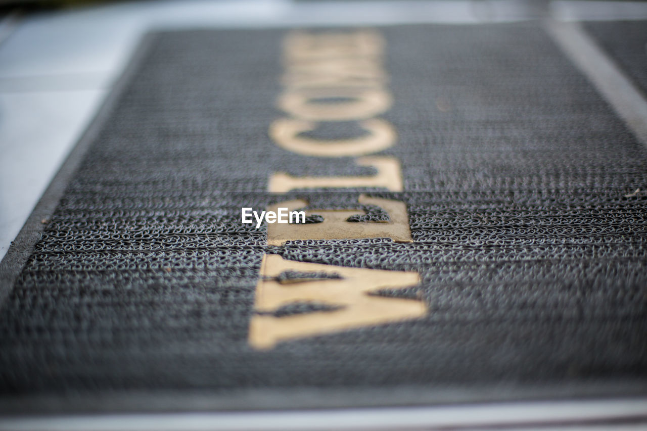 selective focus, communication, no people, close-up, indoors, text, still life, currency, high angle view, number, finance, western script, capital letter, pattern, black color, table, sign, wealth, letter, surface level