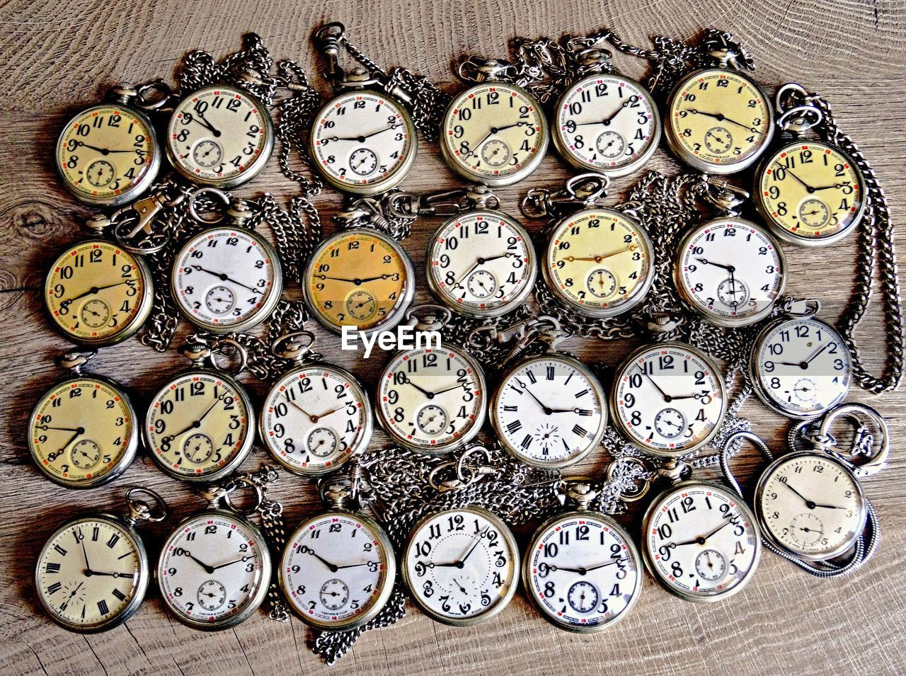 Directly above shot of pocket watches on wooden table