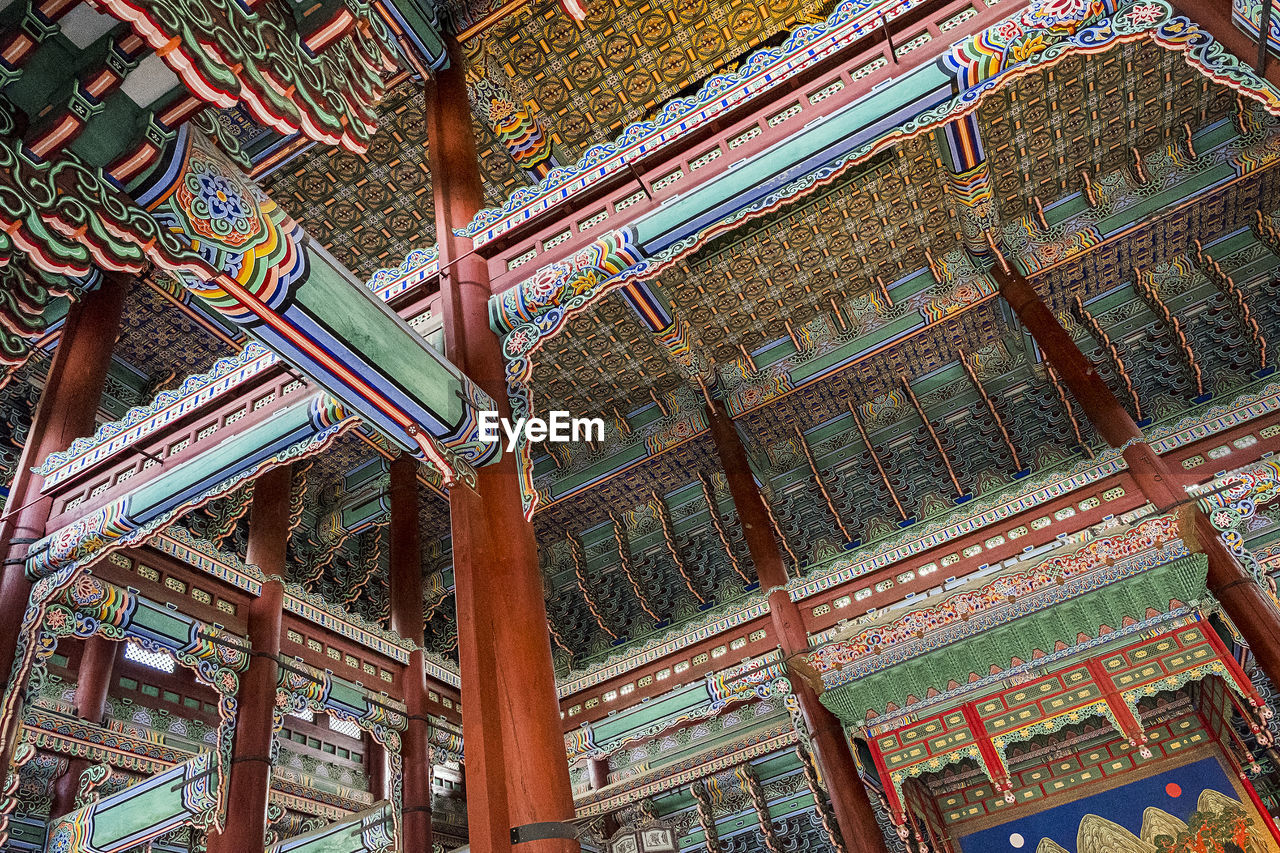 low angle view, built structure, architecture, place of worship, building, day, building exterior, religion, no people, pattern, belief, spirituality, roof, art and craft, outdoors, multi colored, ceiling, architectural column, roof beam