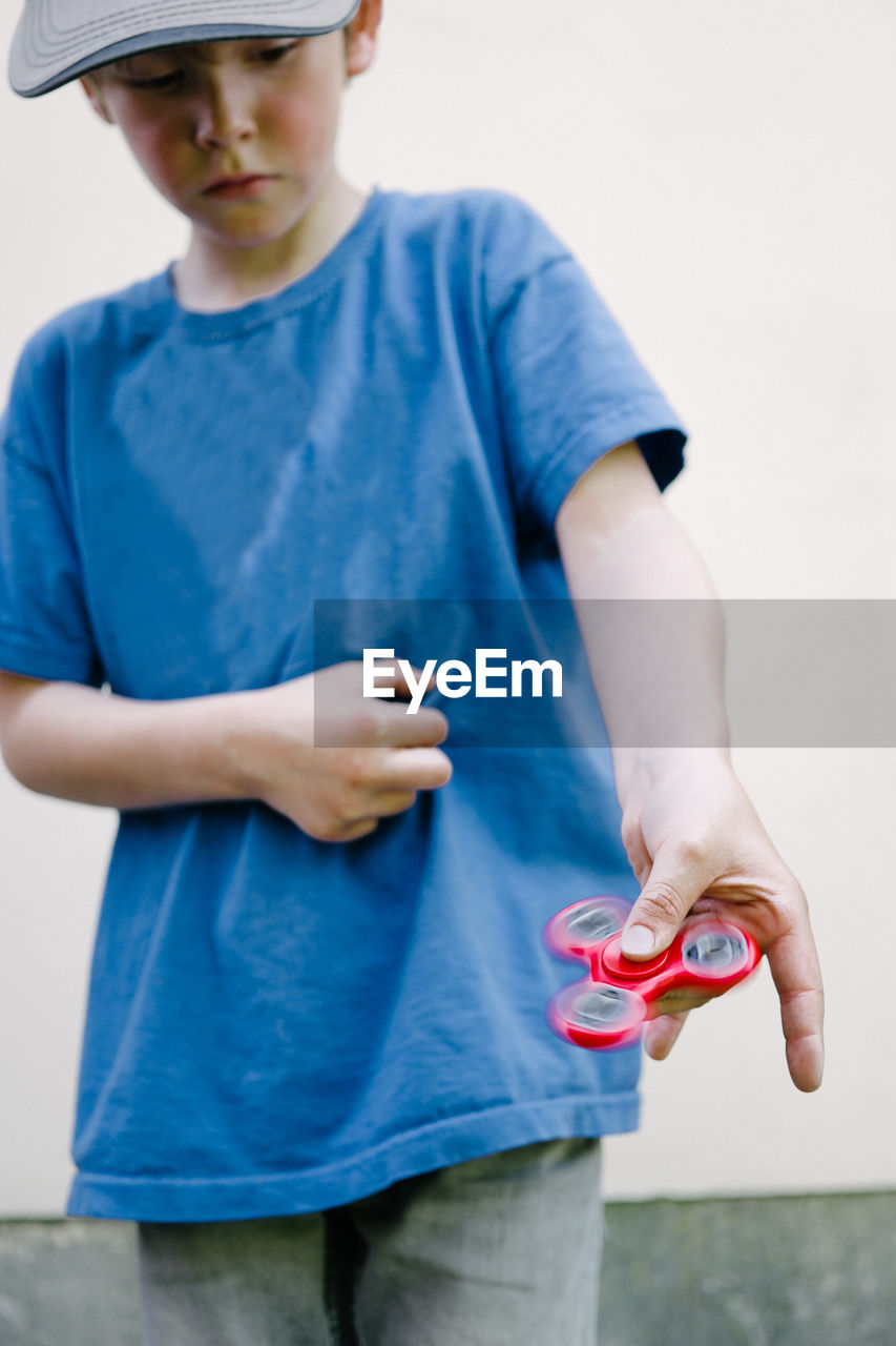 Boy Playing With Fidget Spinner Gadget Toy