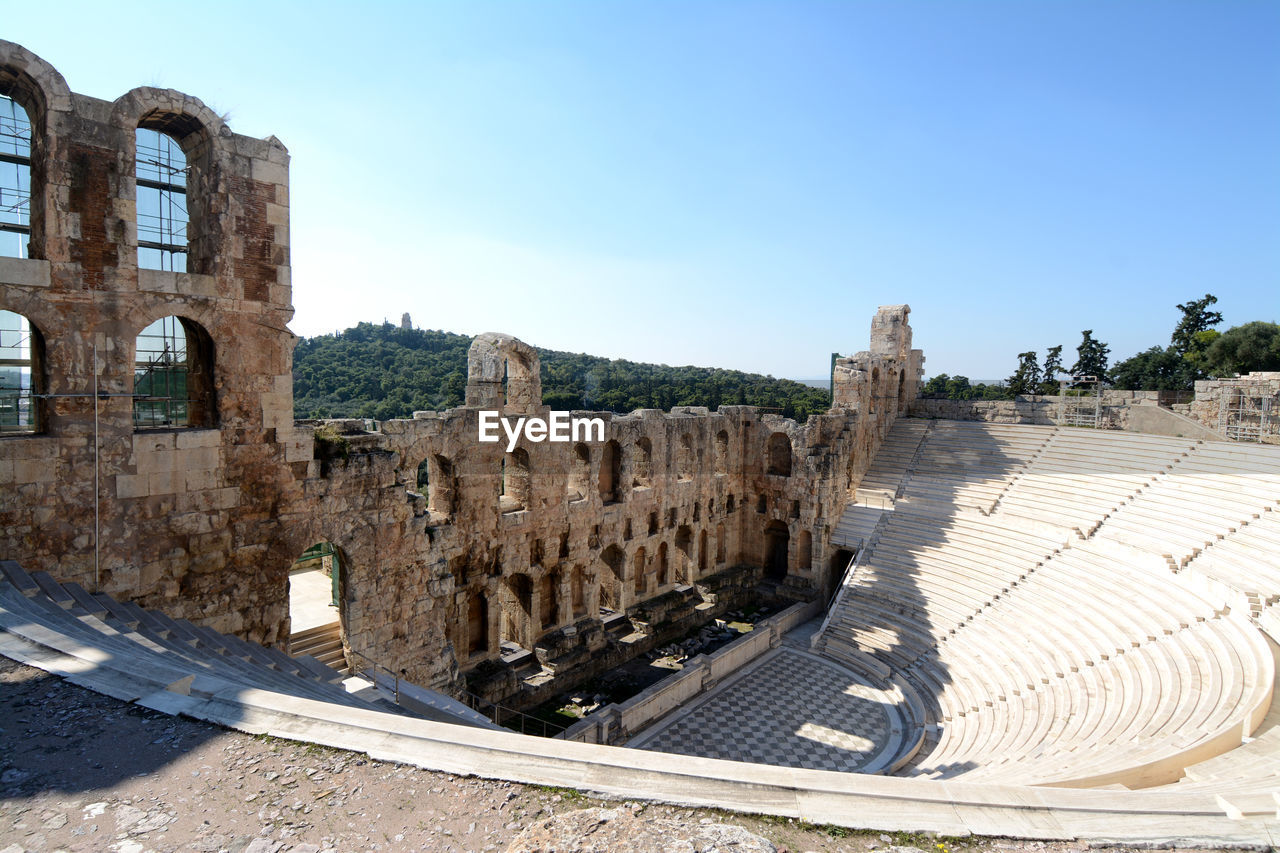 architecture, sky, built structure, history, the past, ancient, building exterior, travel, nature, travel destinations, tourism, old ruin, day, amphitheater, no people, sunlight, old, city, blue, clear sky, ancient civilization, outdoors, archaeology, ruined
