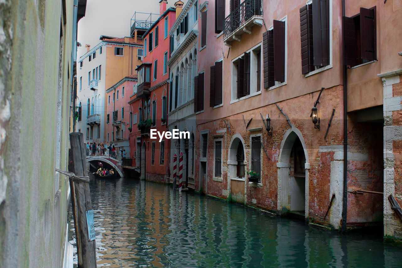 architecture, building exterior, built structure, water, window, canal, waterfront, residential building, mode of transport, day, transportation, outdoors, no people, nautical vessel, sky, city