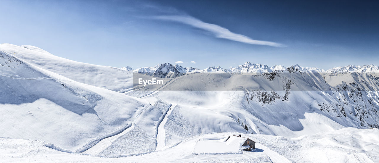 snow, winter, tranquil scene, cold temperature, beauty in nature, scenics, nature, tranquility, white color, mountain, snowcapped mountain, weather, day, sky, mountain range, no people, outdoors, sunlight, blue