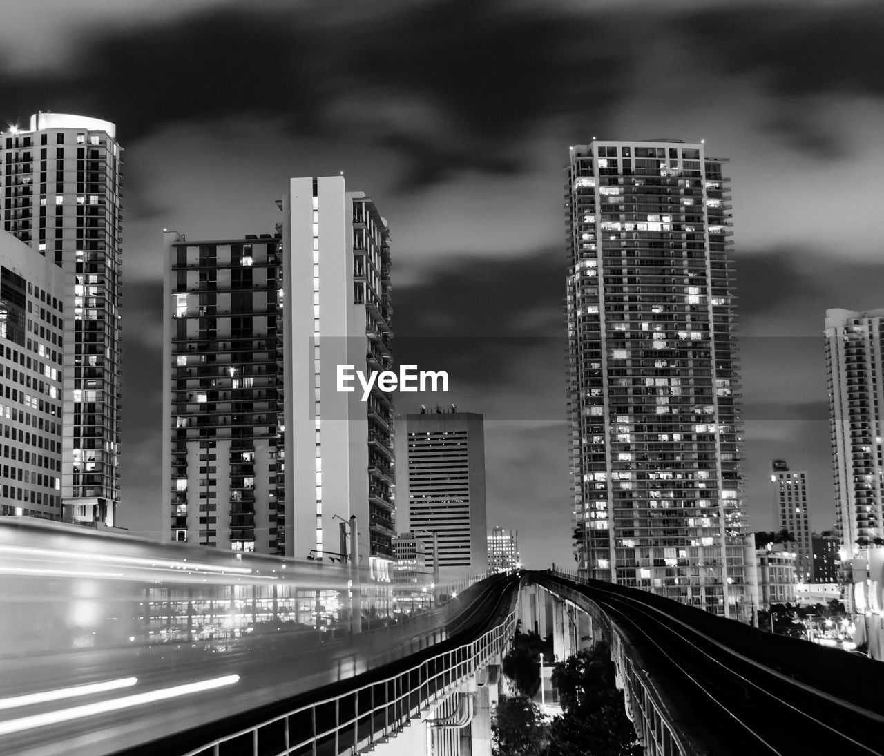 Blurred Motion Of Train Against Buildings At Night