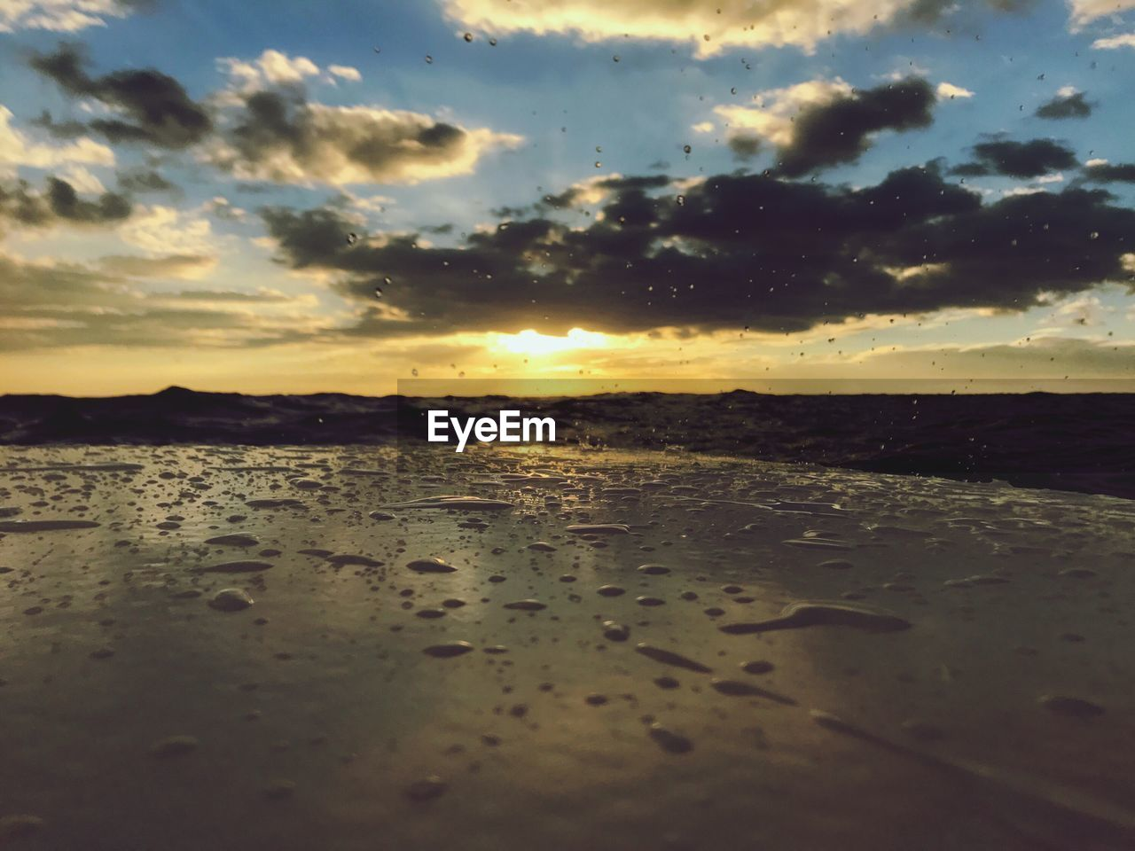 sunset, water, nature, beauty in nature, sky, tranquility, reflection, no people, scenics, wet, tranquil scene, cloud - sky, beach, outdoors, sea, day, close-up