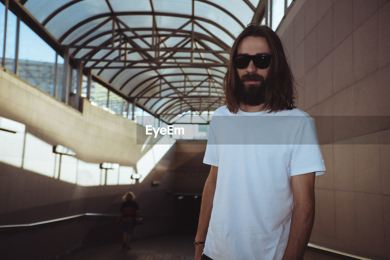 Portrait Of Man Wearing Sunglasses While Standing In Tunnel