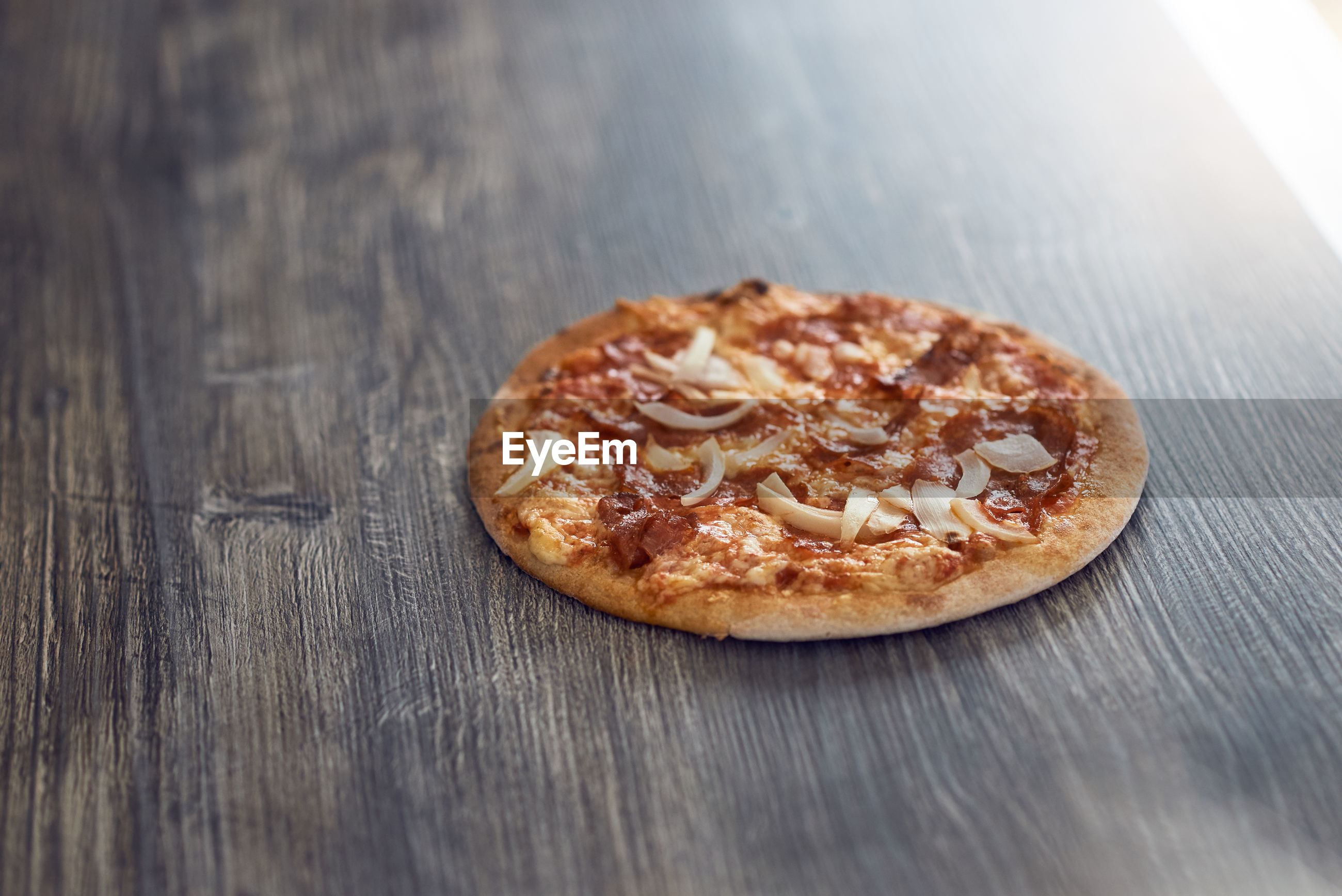 High Angle View Of Grilled Pizza On Wooden Table
