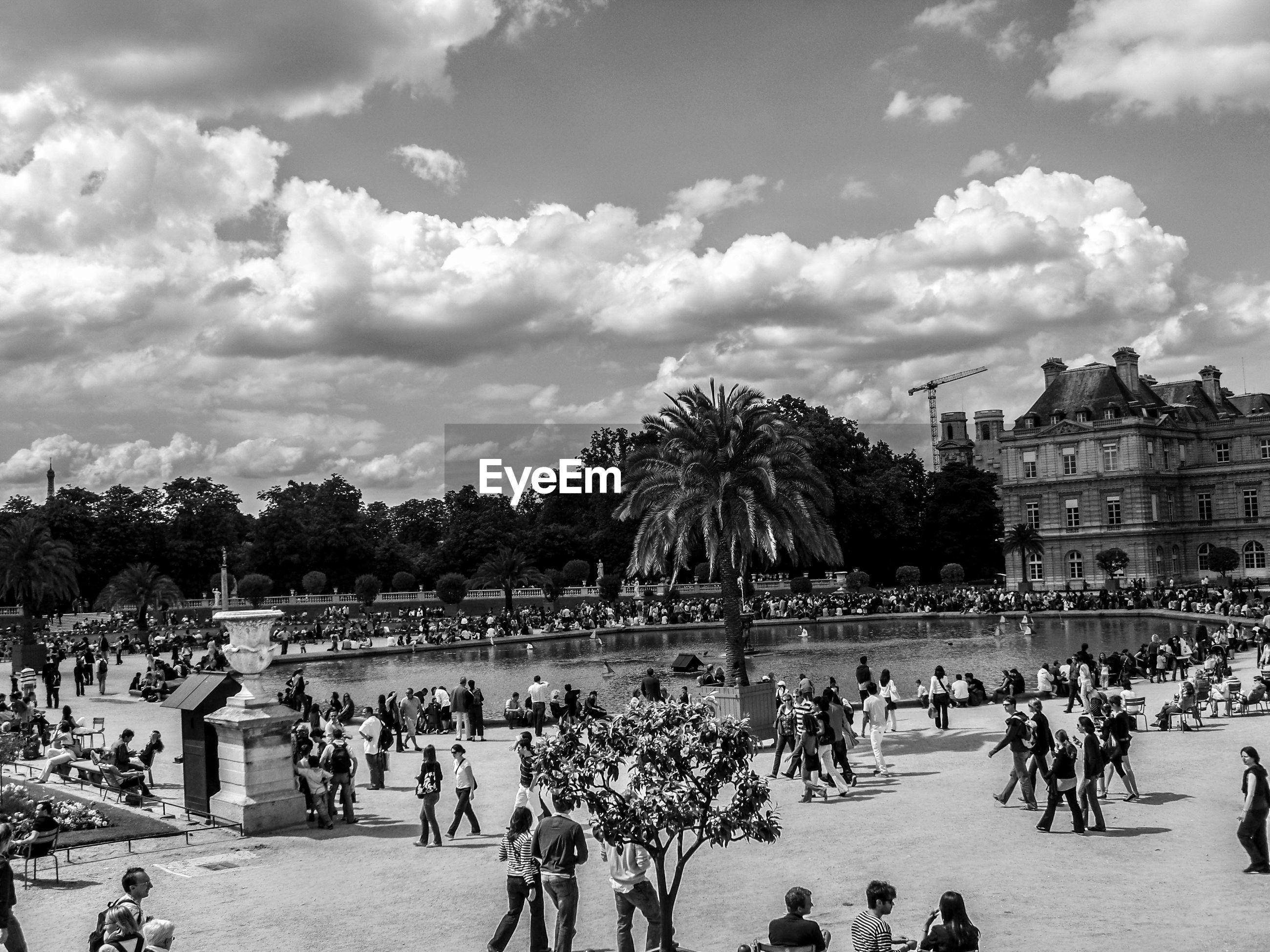 Tourists at le jardin du luxembourg against sky
