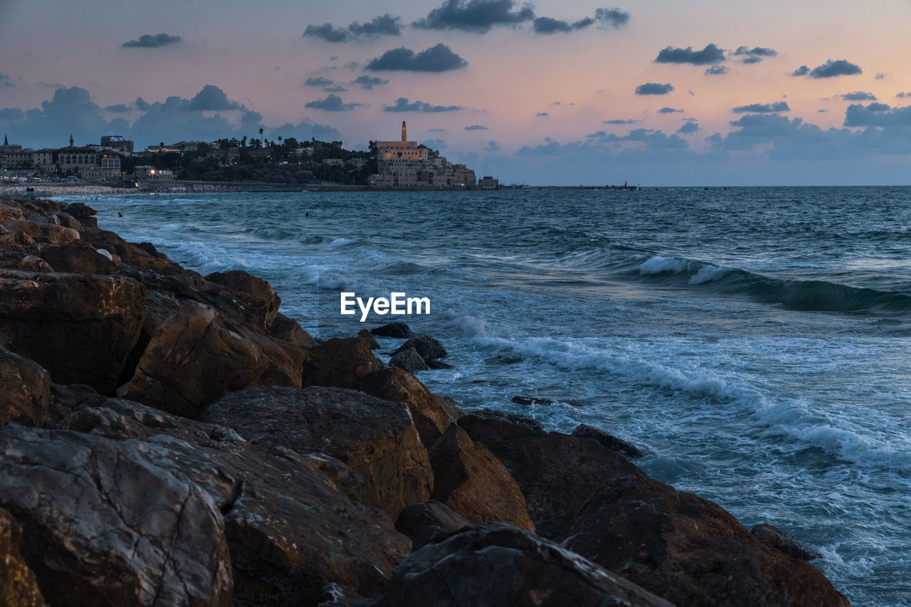 sea, water, sky, rock, rock - object, solid, beach, sunset, beauty in nature, scenics - nature, land, cloud - sky, motion, nature, wave, horizon over water, horizon, no people, tranquility, outdoors, rocky coastline