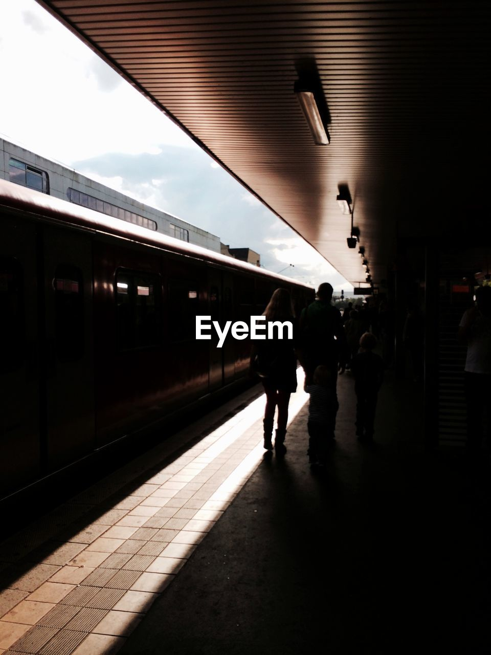 Silhouette Of People On Train Station