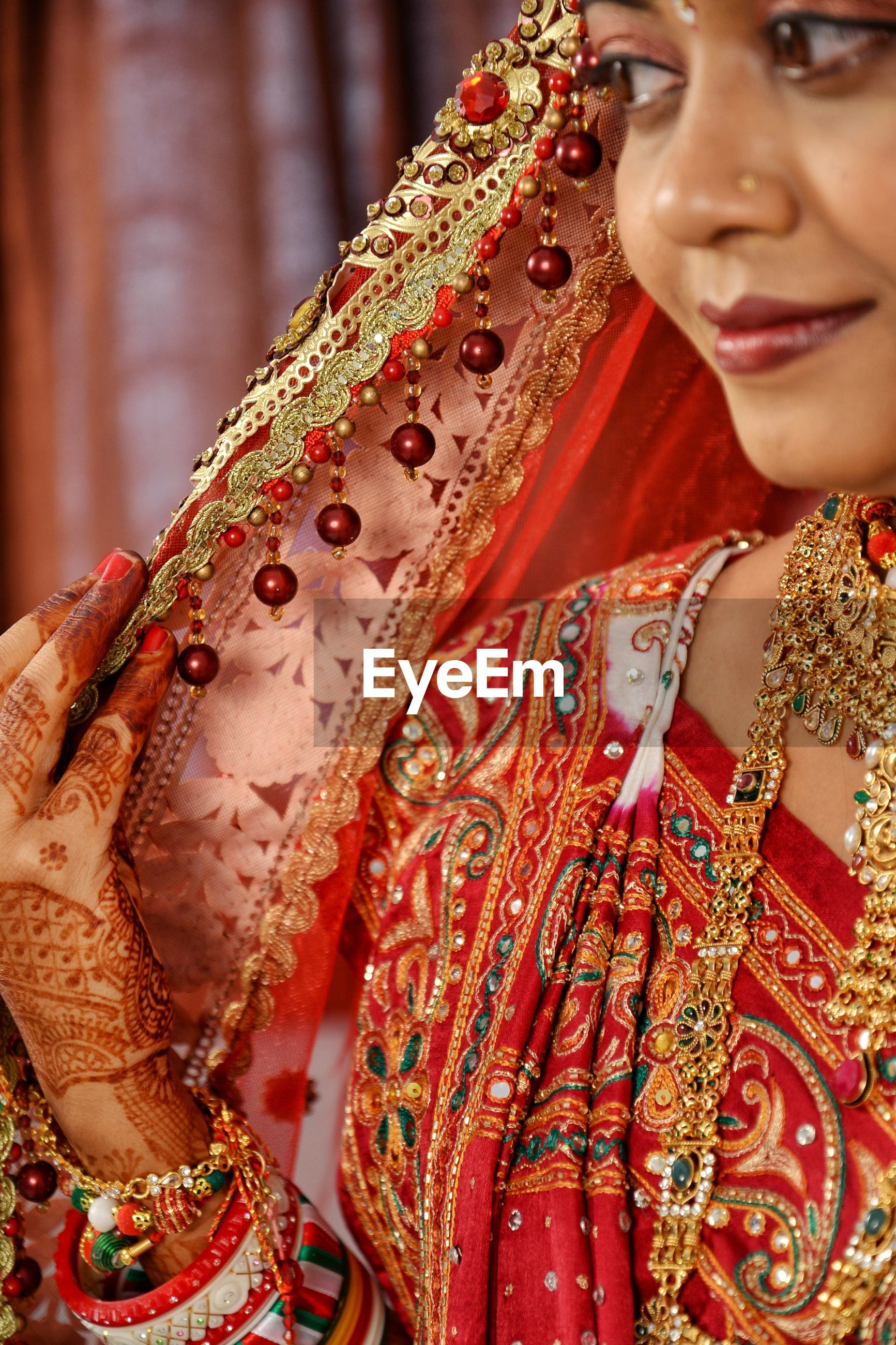 Close-up of beautiful smiling young bride at home