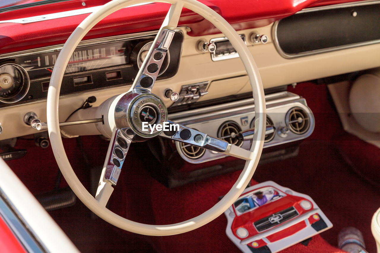 red, vehicle interior, mode of transport, transportation, land vehicle, steering wheel, car, car interior, dashboard, fire engine, speedometer, no people, day, close-up, outdoors