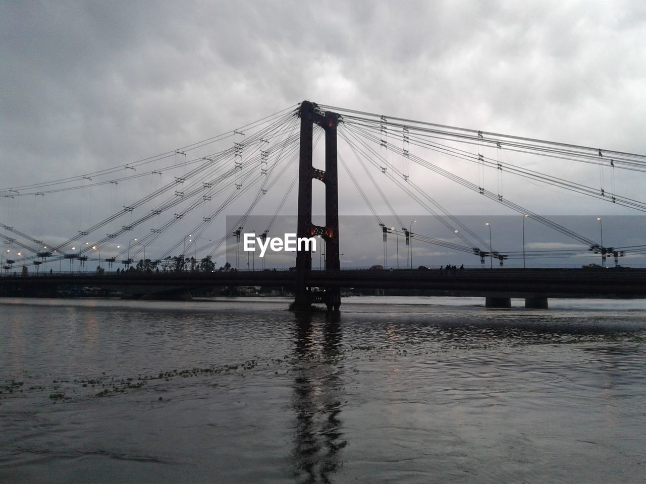 connection, bridge - man made structure, sky, cloud - sky, built structure, river, suspension bridge, water, architecture, waterfront, cable, outdoors, transportation, day, no people, nature
