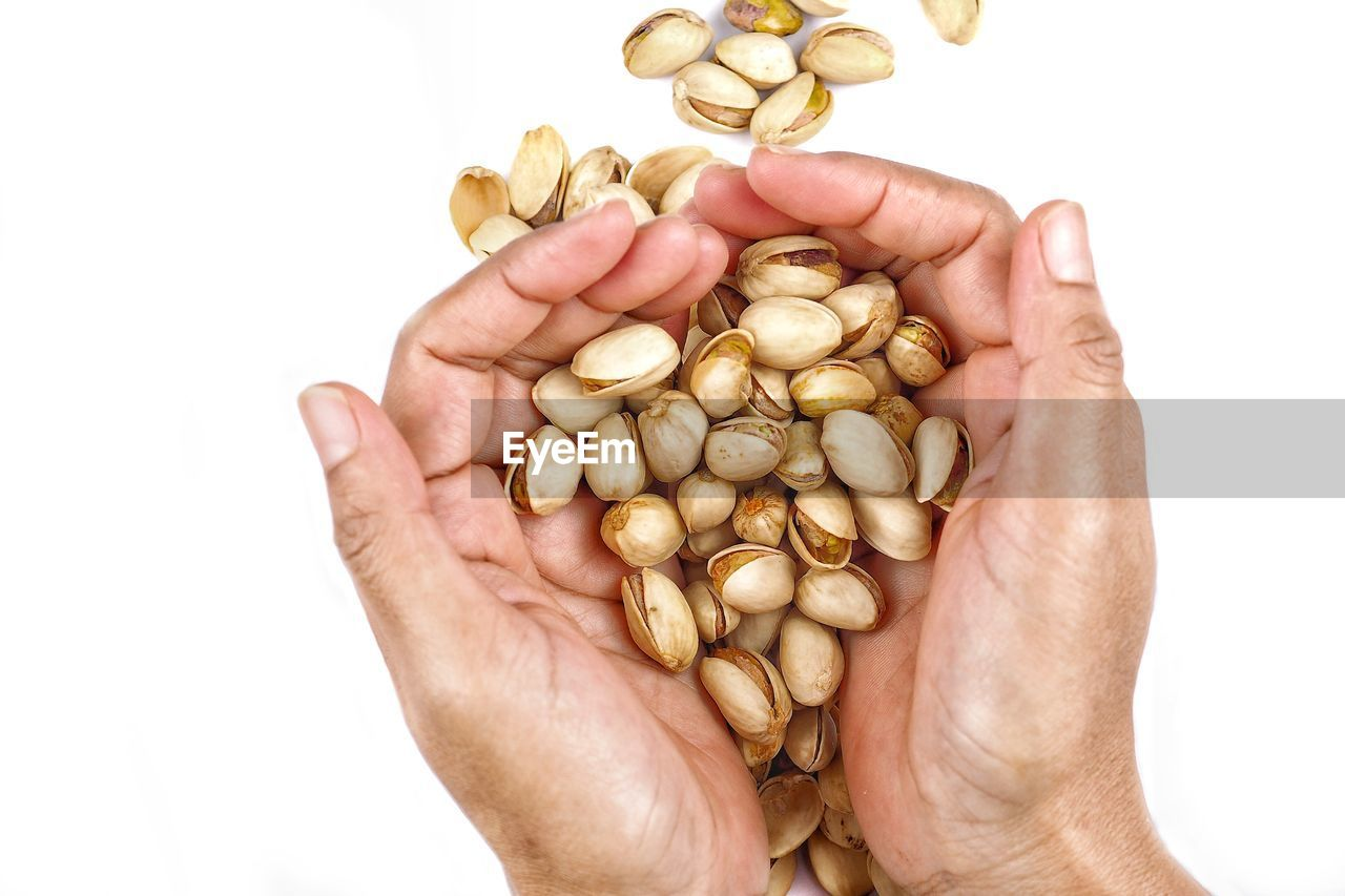 studio shot, human body part, large group of objects, white background, human hand, food and drink, hand, wellbeing, food, indoors, holding, cut out, close-up, nut - food, abundance, healthy eating, nut, unrecognizable person, one person, hands cupped, finger