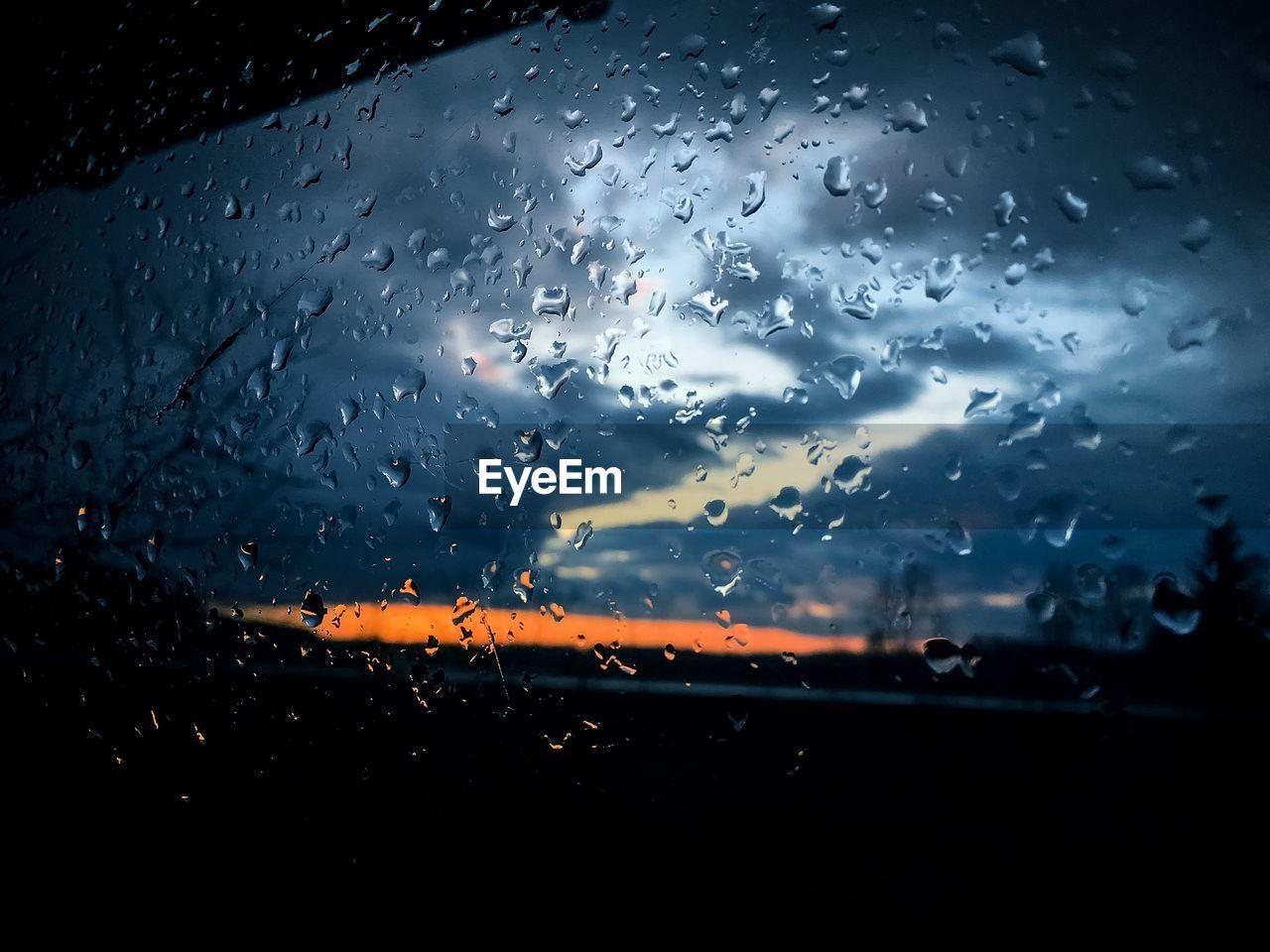 drop, wet, rain, window, water, raindrop, weather, no people, sunset, sky, nature, dusk, indoors, close-up, day