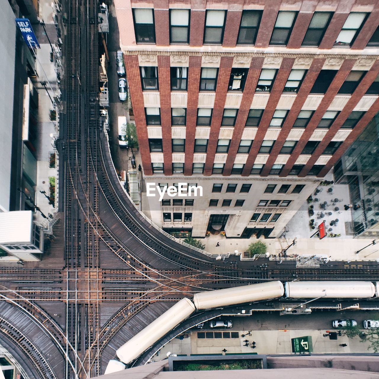 High Angle View Of Railroad Tracks Amidst Buildings