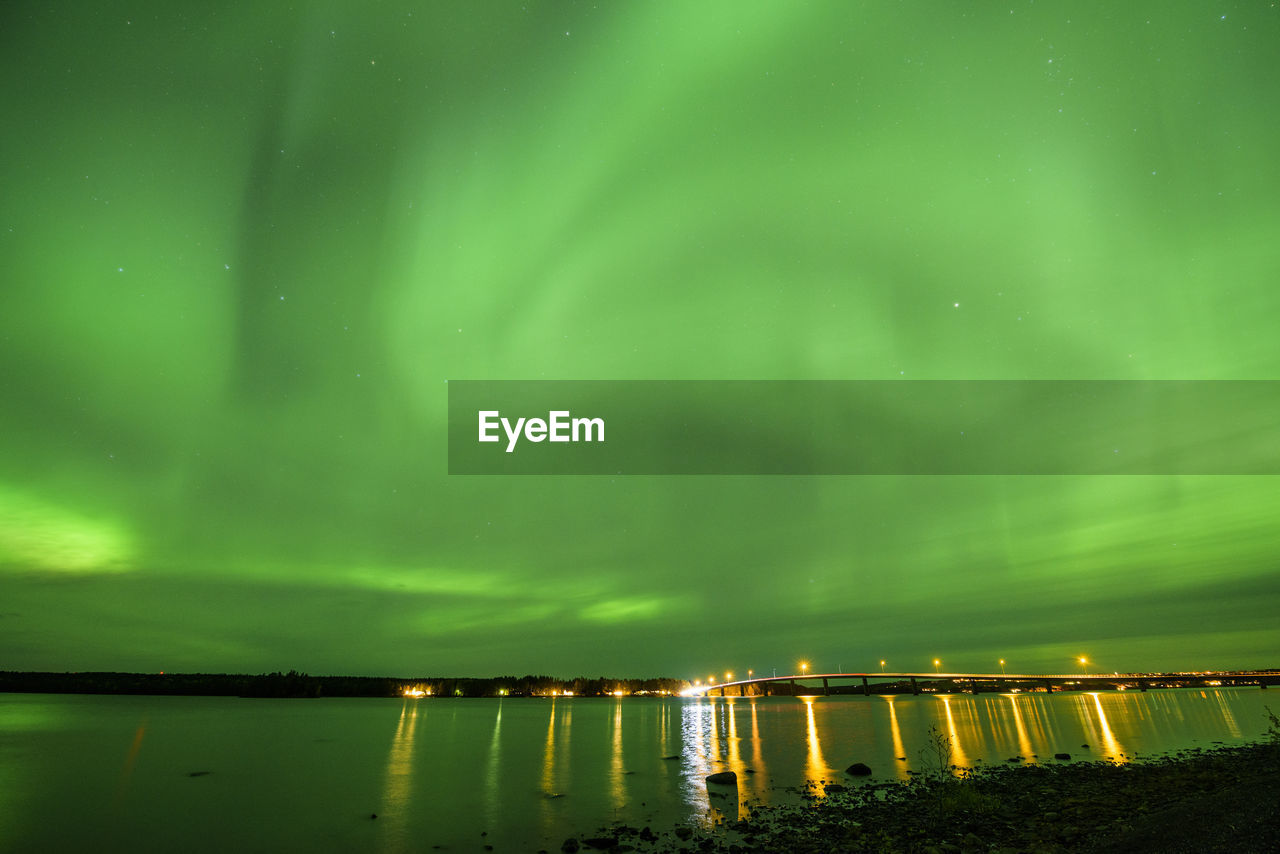 water, green color, beauty in nature, night, illuminated, scenics - nature, no people, reflection, sky, nature, tranquility, lake, star - space, natural phenomenon, tranquil scene, idyllic, non-urban scene, astronomy, long exposure, outdoors, power in nature