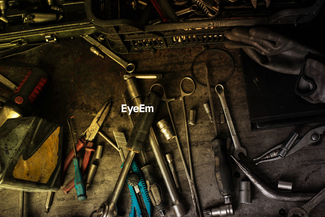 work tool, indoors, metal, tool, still life, large group of objects, hand tool, no people, high angle view, workshop, variation, choice, old, screwdriver, equipment, technology, complexity, mechanic, close-up, occupation, garage, spanner