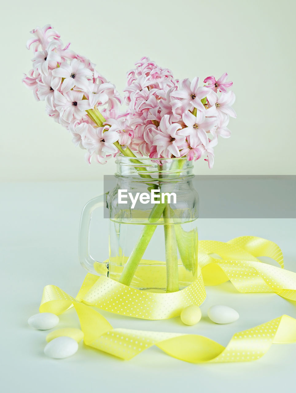 flower, flowering plant, freshness, table, plant, container, indoors, nature, still life, beauty in nature, no people, jar, glass - material, close-up, fragility, vulnerability, vase, transparent, studio shot, flower head, flower arrangement, lilac