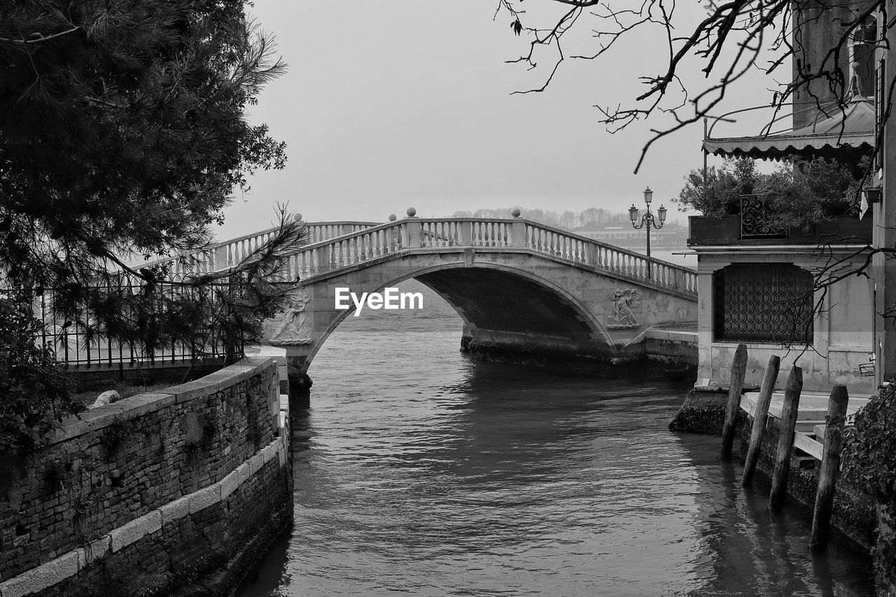 bridge, bridge - man made structure, water, connection, built structure, architecture, arch, river, transportation, tree, sky, nature, plant, arch bridge, no people, waterfront, day, outdoors, arched