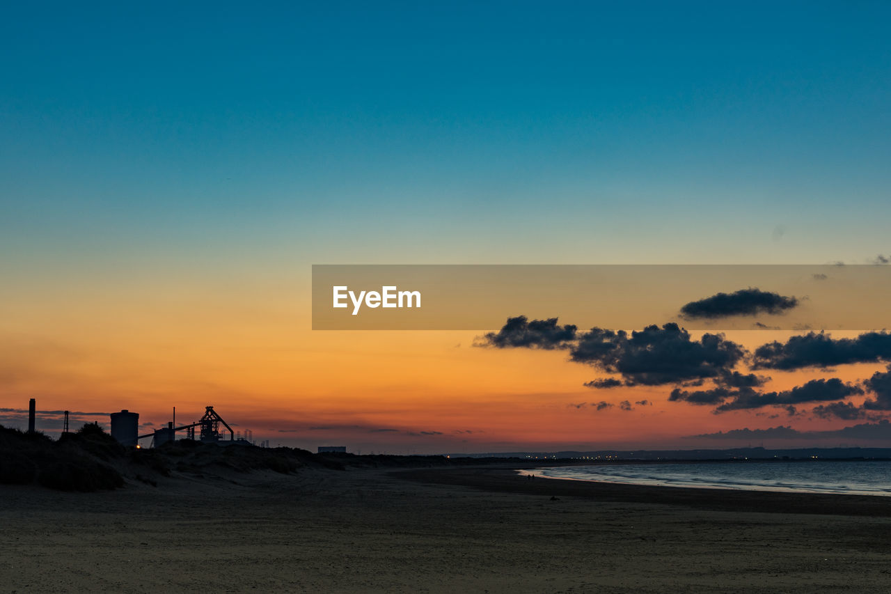 sunset, sky, sea, beach, water, land, beauty in nature, scenics - nature, orange color, horizon, tranquil scene, tranquility, horizon over water, nature, cloud - sky, idyllic, silhouette, copy space, non-urban scene, no people, outdoors