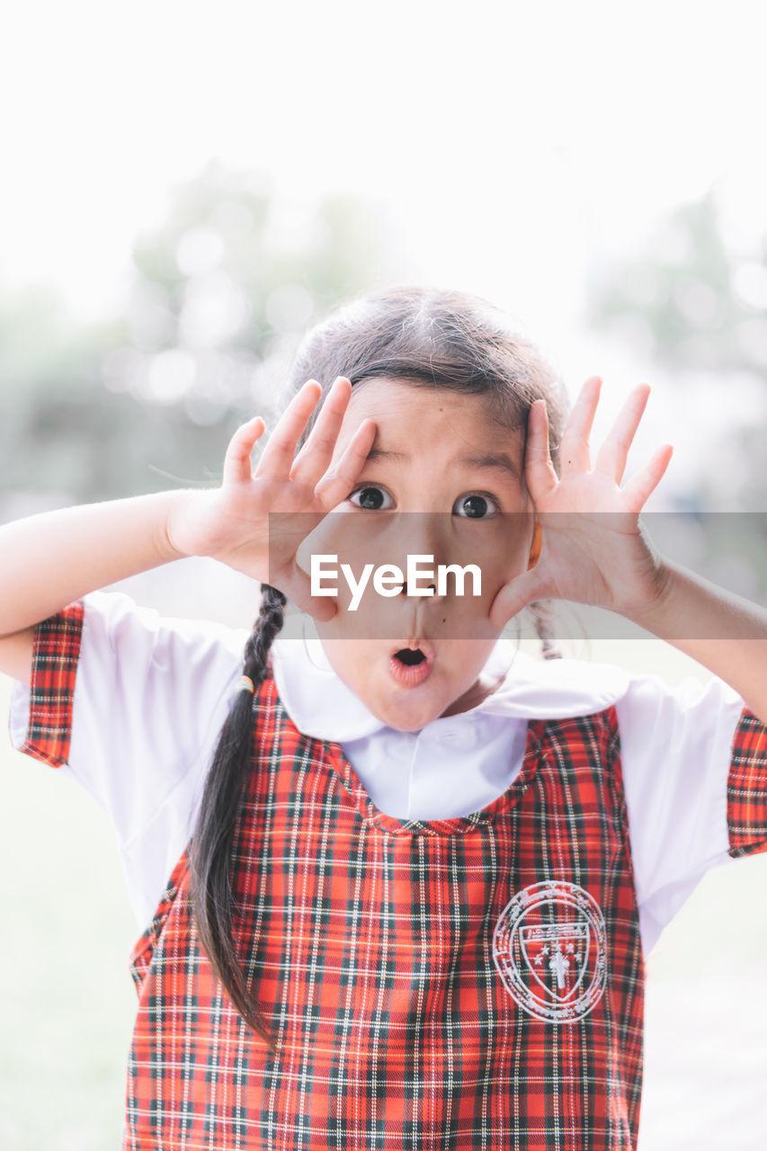 Close-Up Portrait Of Schoolgirl Gesturing