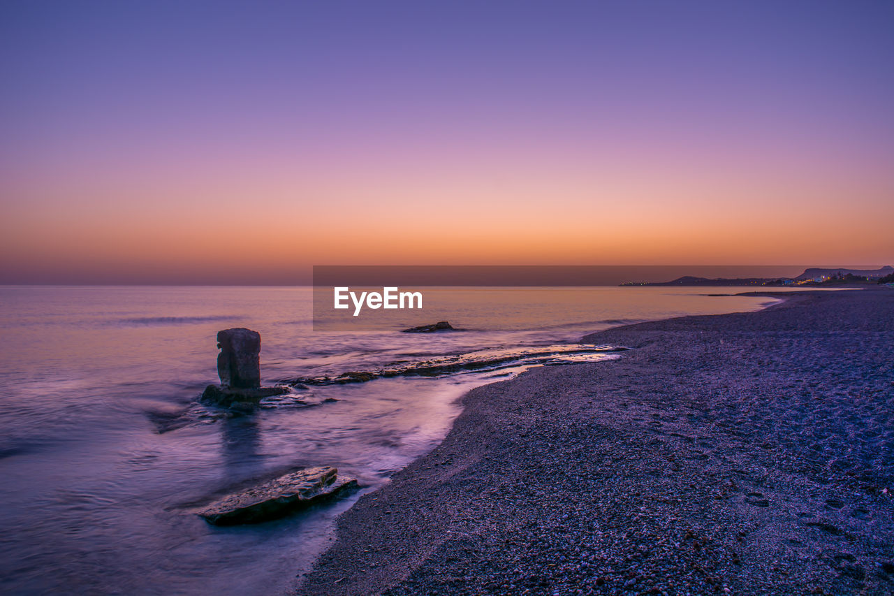 sea, sunset, water, beauty in nature, scenics, horizon over water, nature, tranquil scene, tranquility, no people, sky, beach, clear sky, outdoors, wave, day