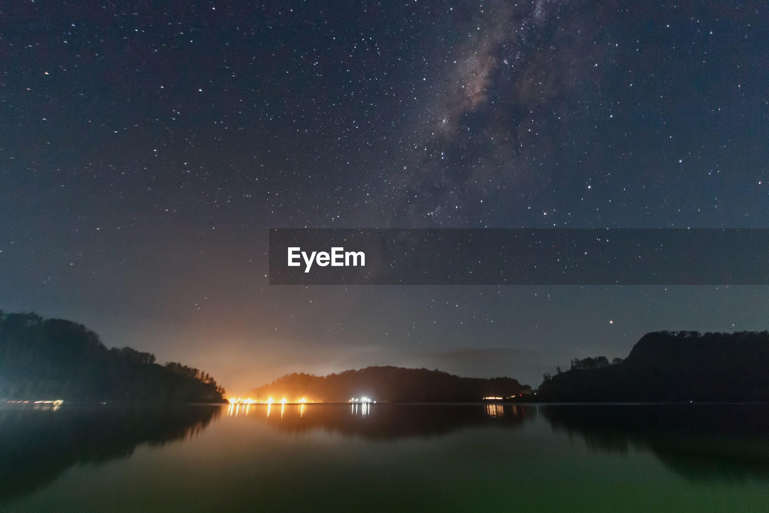 SCENIC VIEW OF LAKE AGAINST STAR FIELD IN SKY AT NIGHT