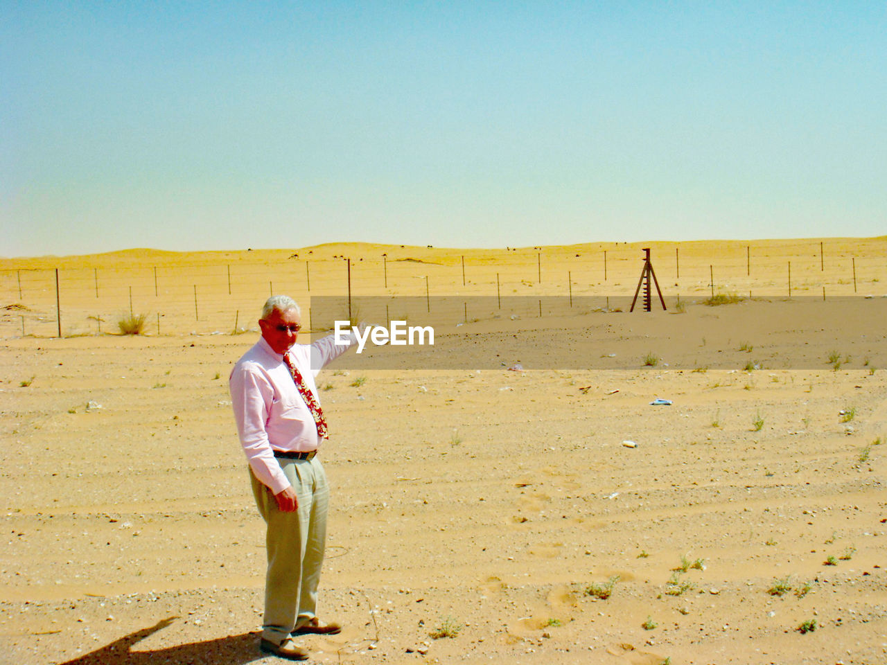 Full Length Of Senior Man Standing At Desert During Sunny Day