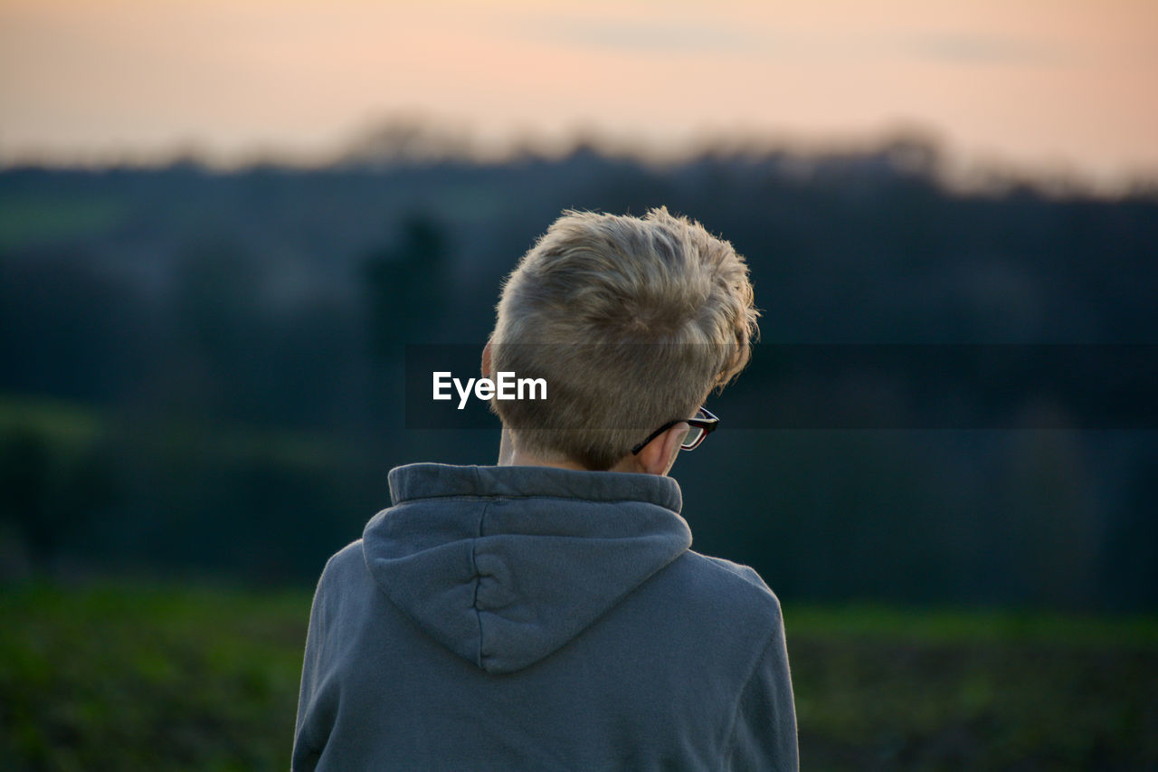 Boy from back looks in the nature