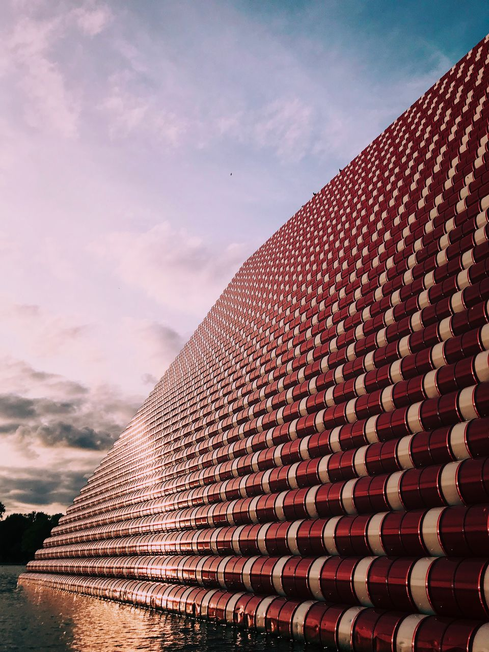 sky, architecture, cloud - sky, built structure, building exterior, pattern, low angle view, building, no people, nature, day, outdoors, roof, roof tile, city, modern, repetition, in a row, sunlight, textured