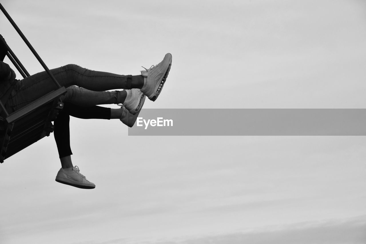sky, one person, day, leisure activity, nature, lifestyles, shoe, real people, low section, human leg, human body part, body part, low angle view, outdoors, cloud - sky, focus on foreground, unrecognizable person, transportation, mode of transportation, human foot
