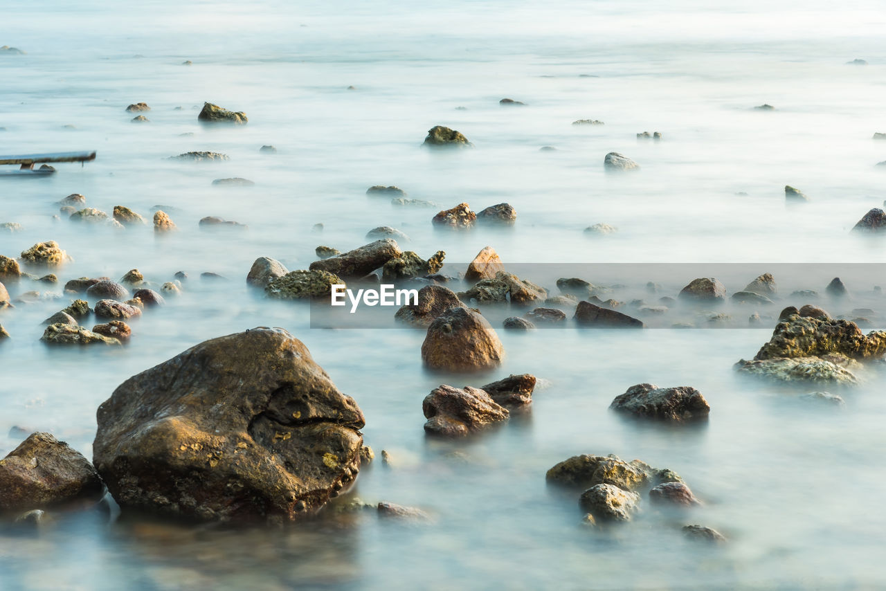 water, rock, sea, rock - object, solid, beauty in nature, no people, nature, beach, day, land, scenics - nature, tranquility, outdoors, motion, tranquil scene, long exposure, sky, rock formation, marine, pebble