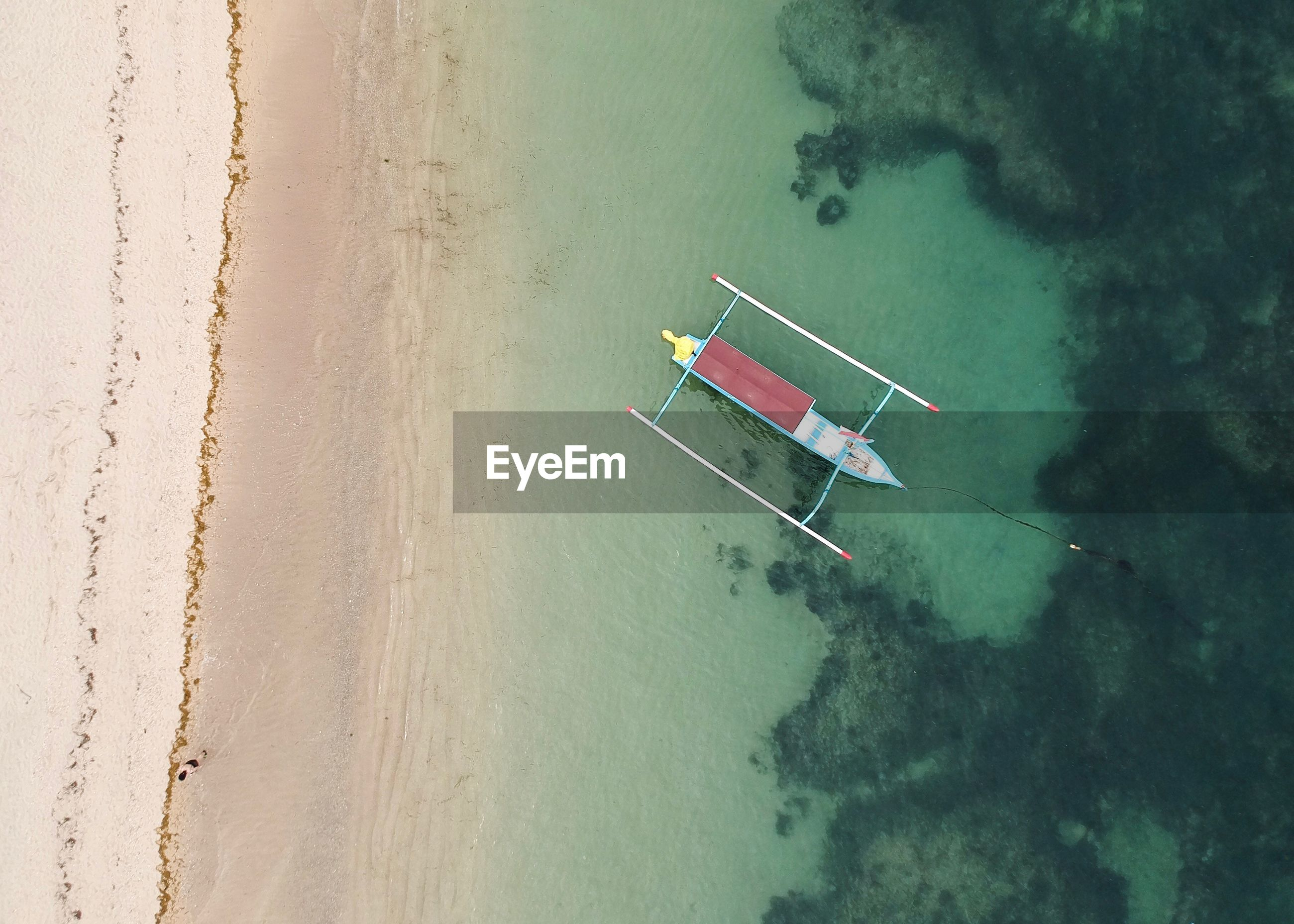 Aerial view of boat on sea against sky