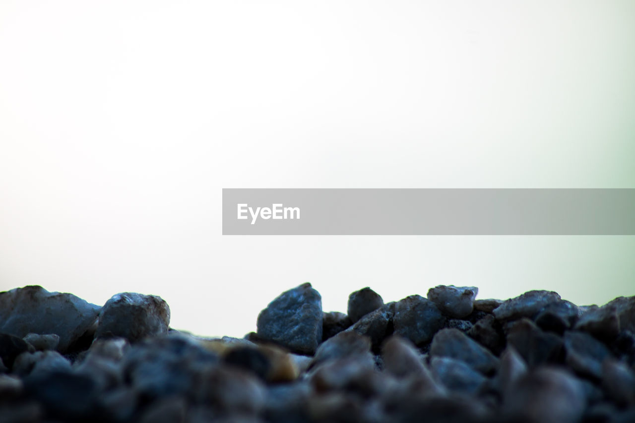 copy space, rock - object, nature, no people, pebble, clear sky, pebble beach, beauty in nature, outdoors, close-up, day, sky