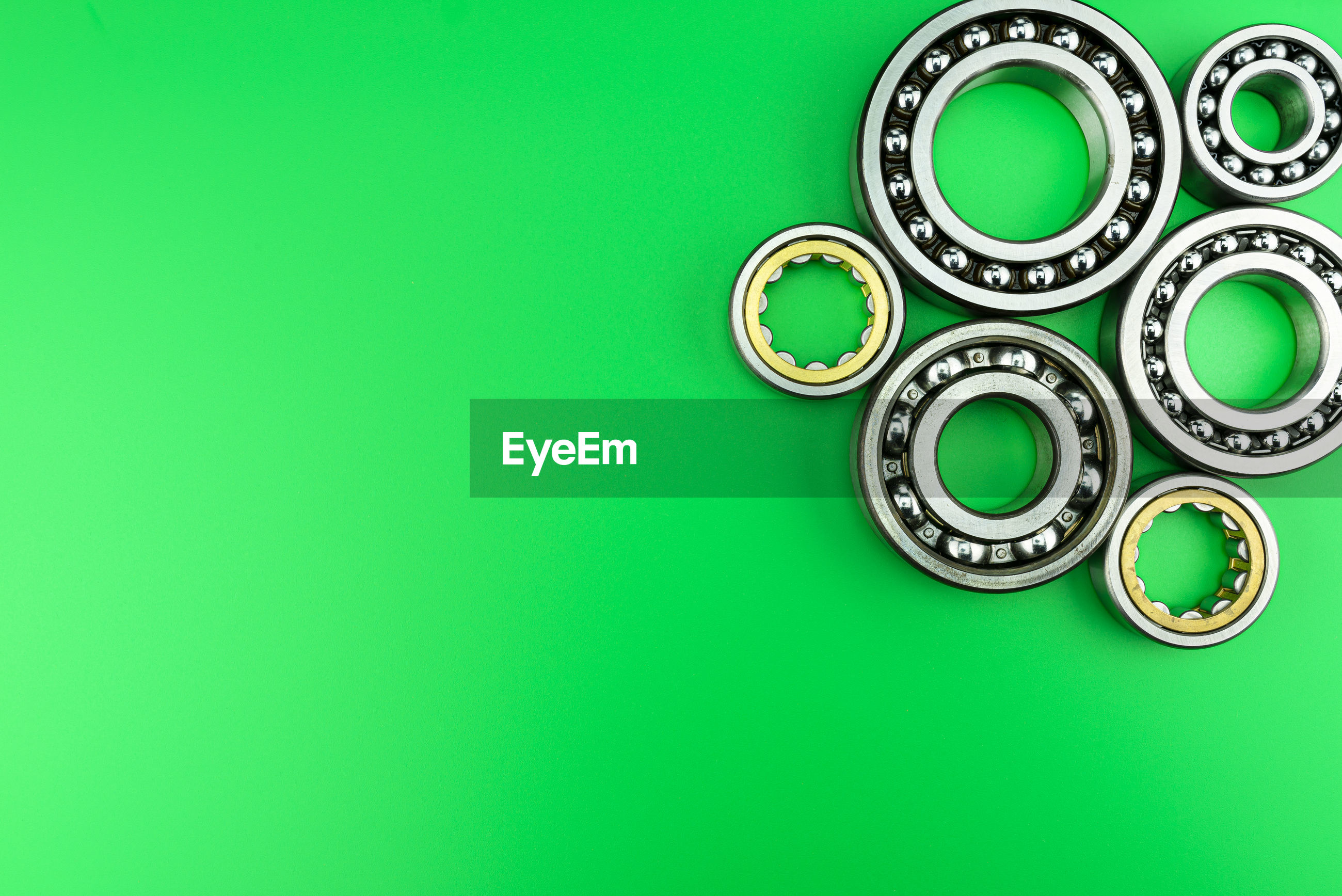 Directly above shot of gears on green background