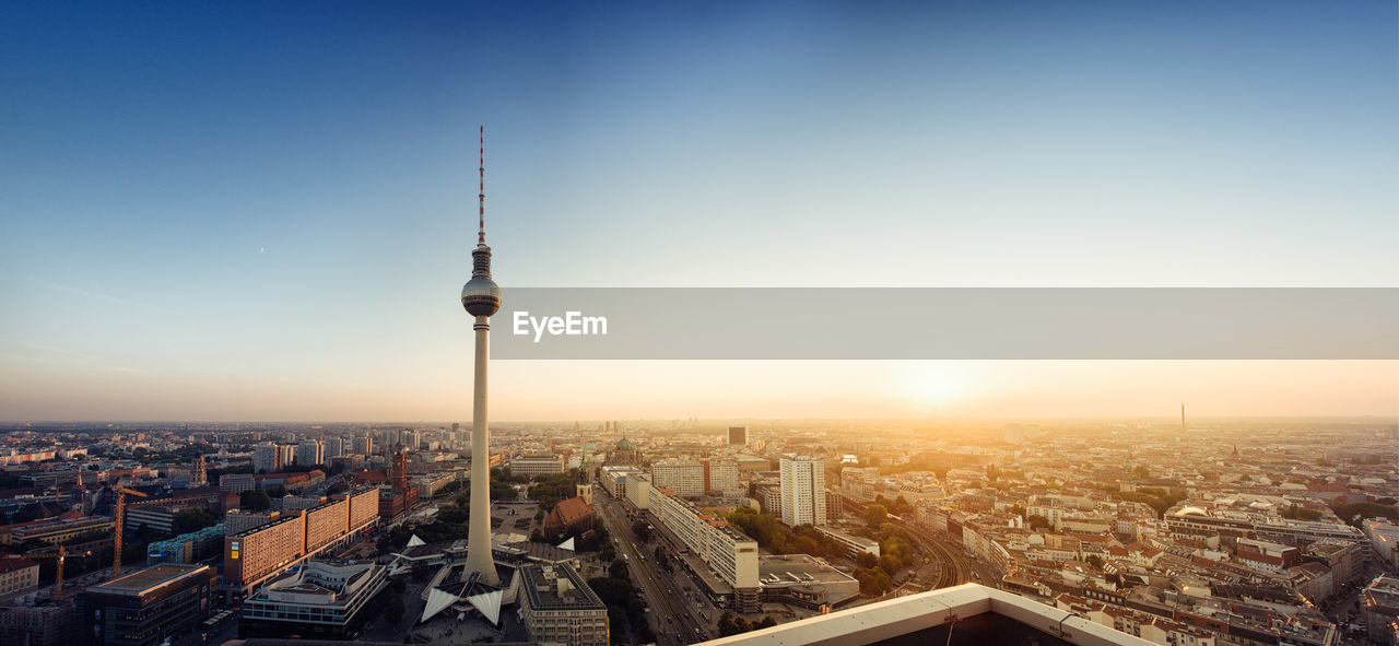 View Of Fernsehturm Against Sky During Sunset