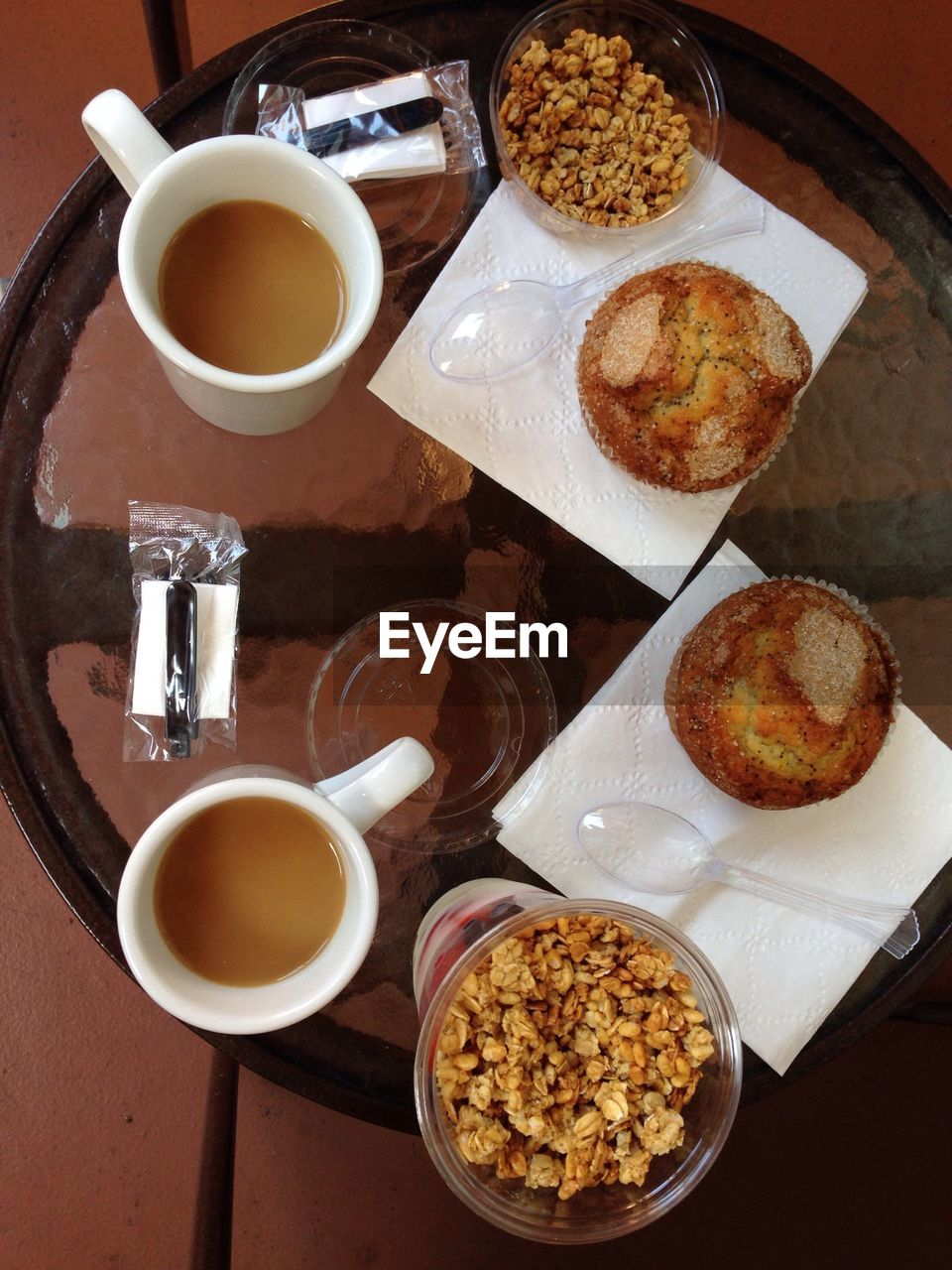 Top view image of coffee cups, baked goods and cereals