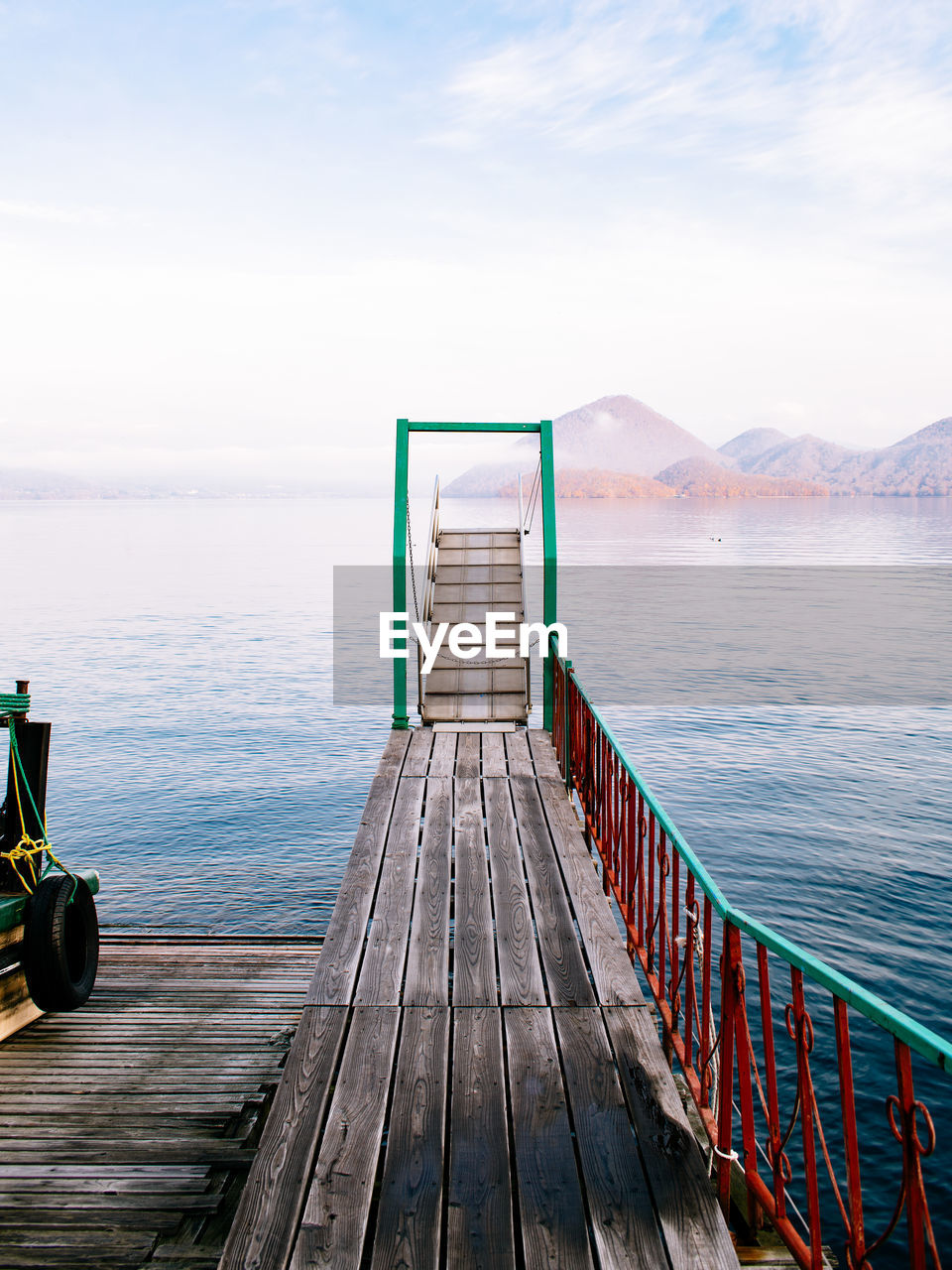 sky, water, wood - material, beauty in nature, scenics - nature, nature, tranquil scene, sea, tranquility, cloud - sky, the way forward, pier, direction, day, no people, railing, wood paneling, idyllic, empty, outdoors, horizon over water, wood, long