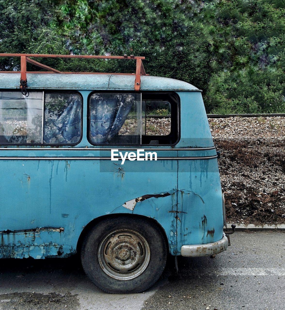 Abandoned Vintage Car On Road