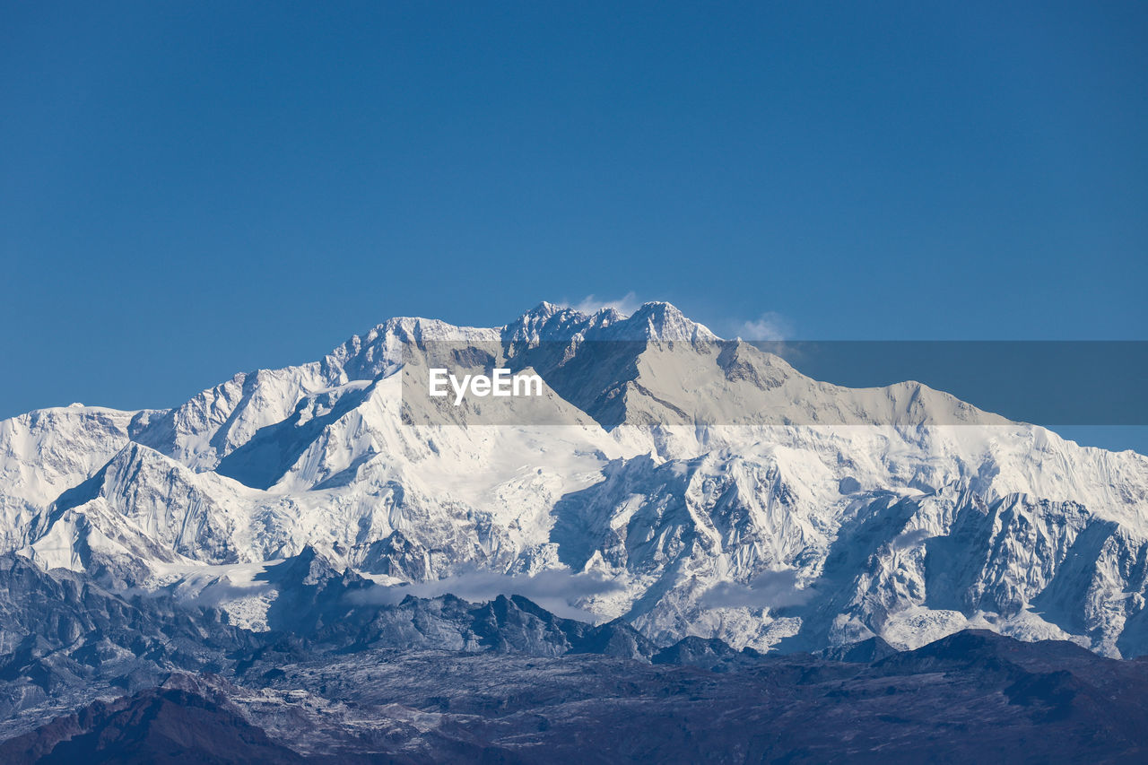 mountain, sky, winter, scenics - nature, snow, cold temperature, copy space, beauty in nature, blue, clear sky, snowcapped mountain, tranquil scene, mountain range, tranquility, nature, environment, no people, day, non-urban scene, mountain peak, formation, range