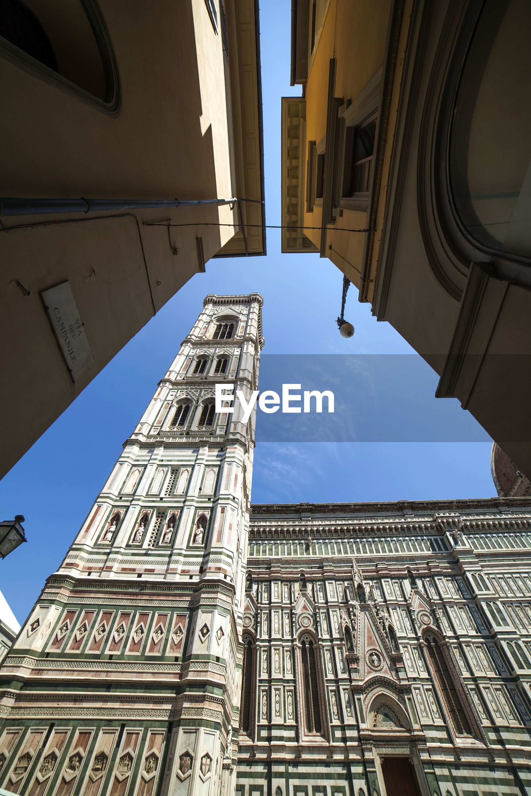 Low angle view of duomo santa maria del fiore during sunny day