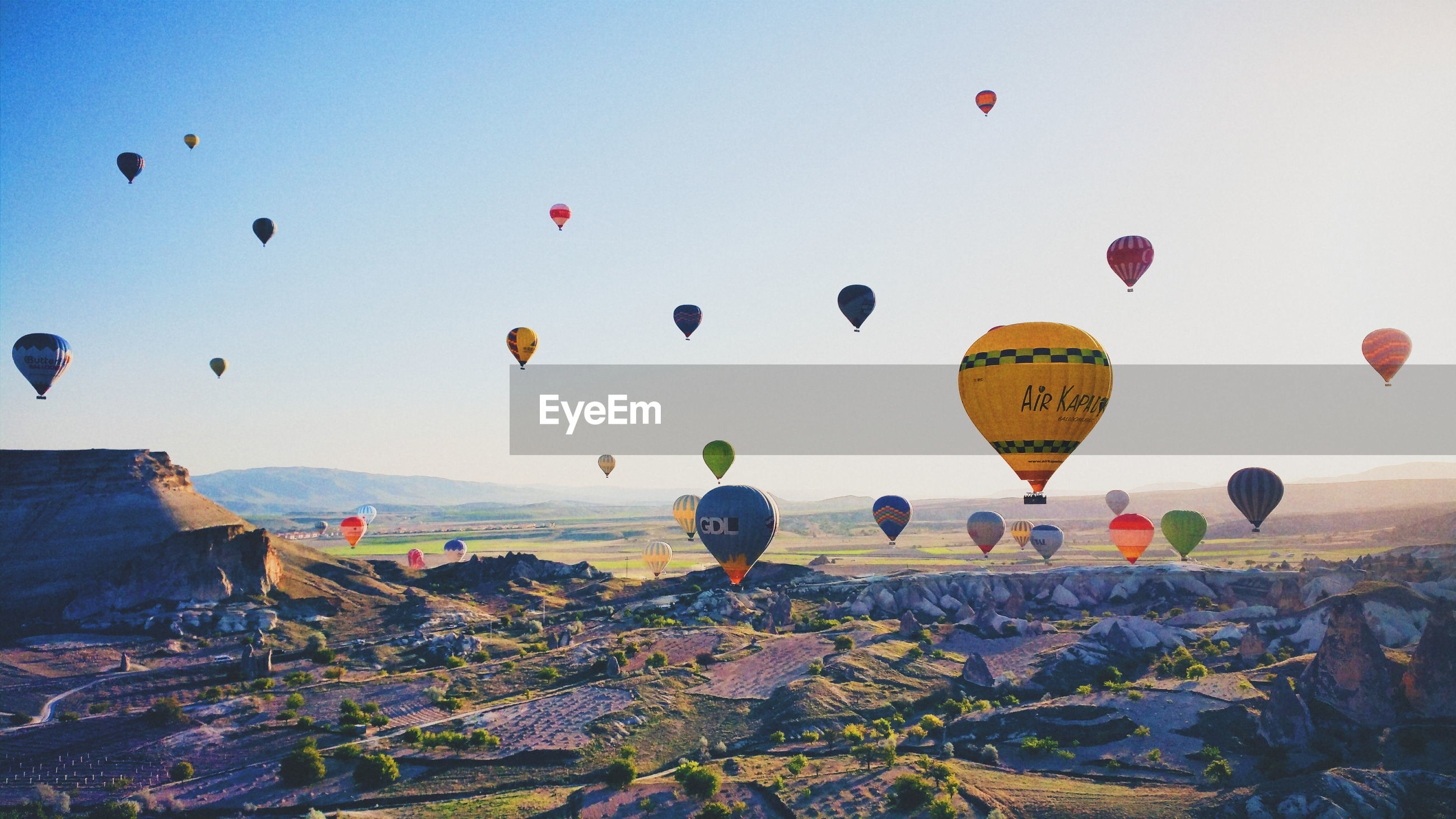 Aerial view of hot air balloons over cappadocia against sky