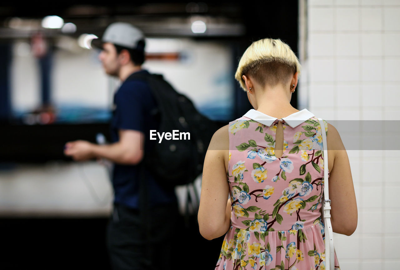 Rear View Of Woman At Railway Station