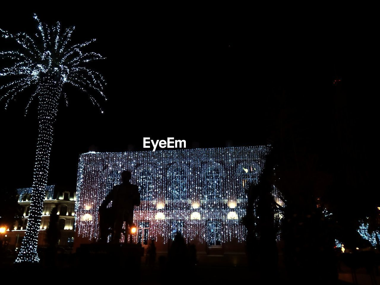 night, illuminated, celebration, christmas, christmas decoration, christmas tree, celebration event, outdoors, christmas lights, tree, large group of people, built structure, architecture, sky, people