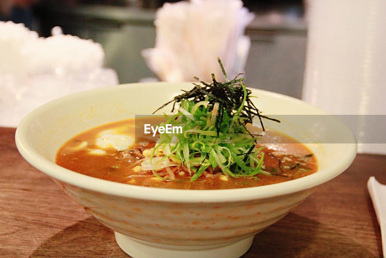 Close-Up Of Ramen Noodles Served In Soup Bowl On Table