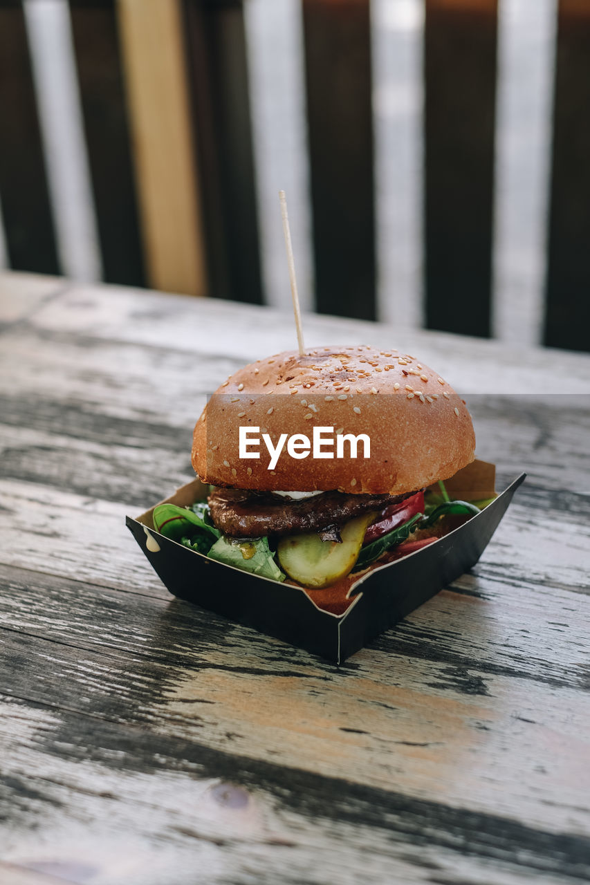 Close-up of a burger in a paper box on table