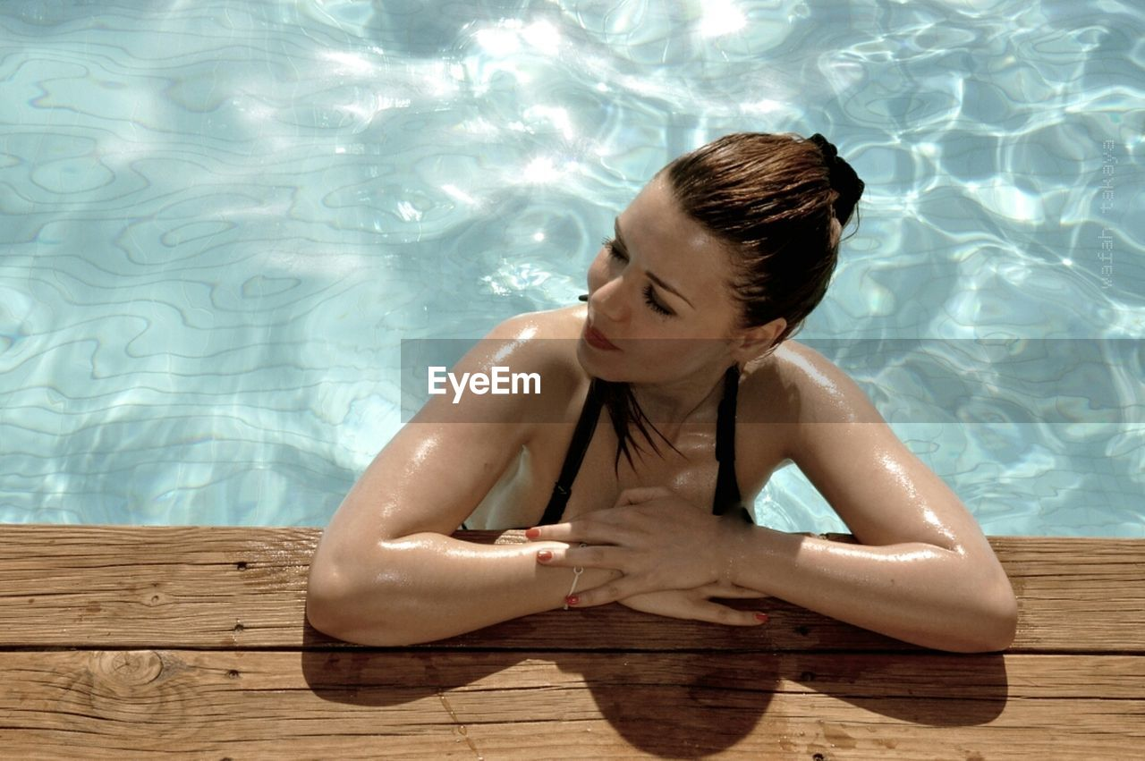 Young woman looking away in swimming pool