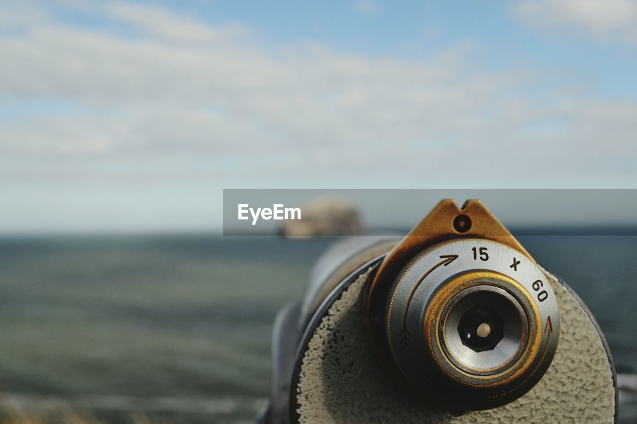 sea, focus on foreground, sky, close-up, water, beach, nature, day, land, metal, binoculars, no people, coin operated, coin-operated binoculars, outdoors, beauty in nature, scenics - nature, technology, optical instrument, silver colored, hand-held telescope